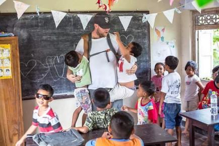 Roger Ramsaur with Bali children